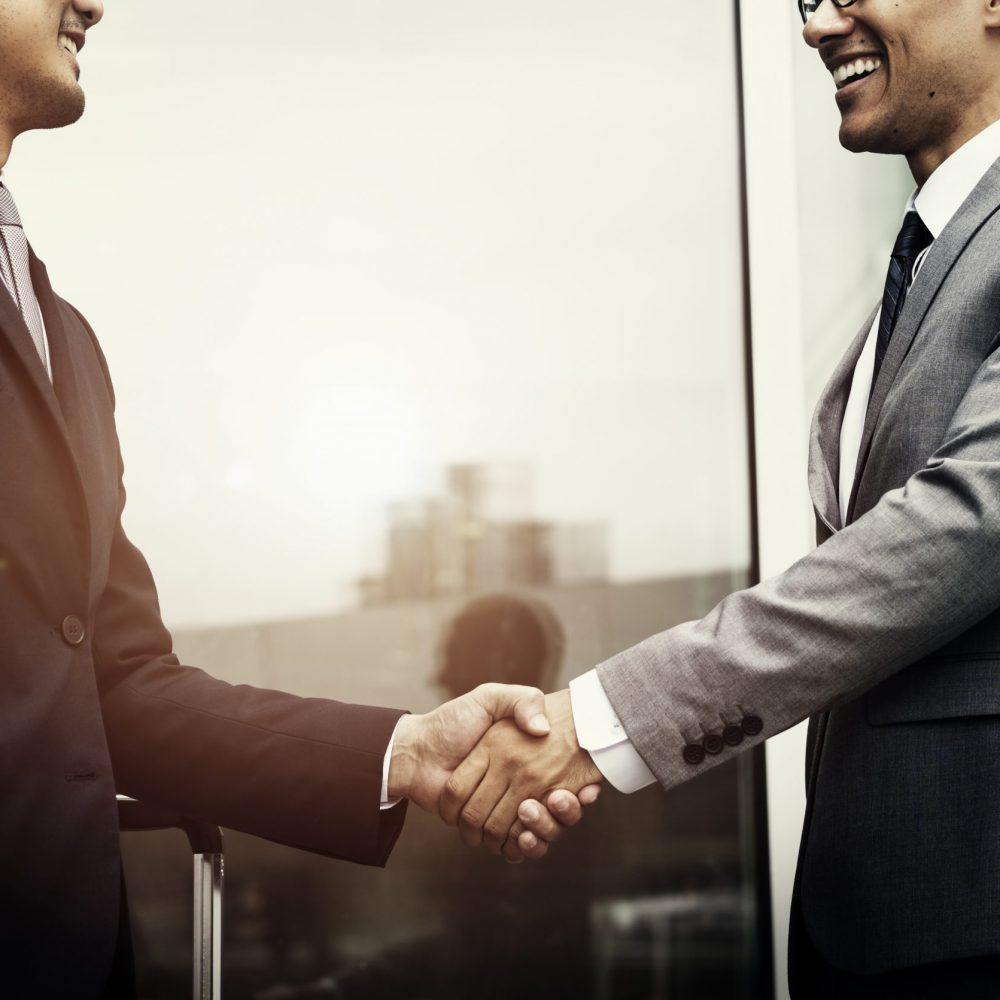 Corporate businessmen shaking hands
